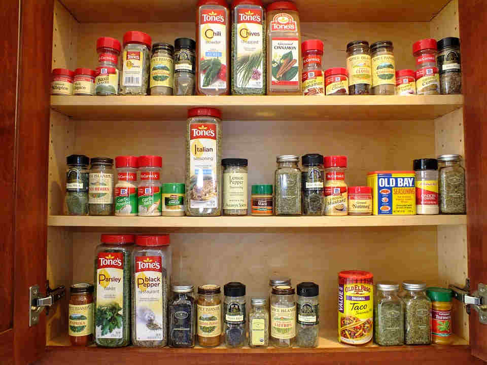 Use a spice rack organizer to maximize space