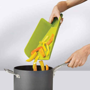 Cut vegetables or fruits slide down easily into cooking pots or containers without spilling.