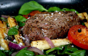 Sprinkle herb salt onto beef steak before serving to enhance the flavour