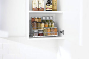 Maximize your kitchen cabinet space and keep spices organized with this pull down spice rack