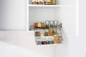 If a person is on the shorter side, having a pull down spice rack may make cooking life much easier. One can see and access them all.