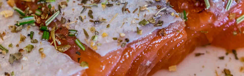 Season fish with herbs and spices to enhance its flavour