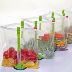 The baggy rack holds the bag and keeps itself vertical while transferring food.