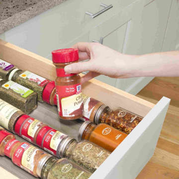 The soft foam keeps spice bottles securely in place. This prevents the bottles from moving when you open or close the drawer.